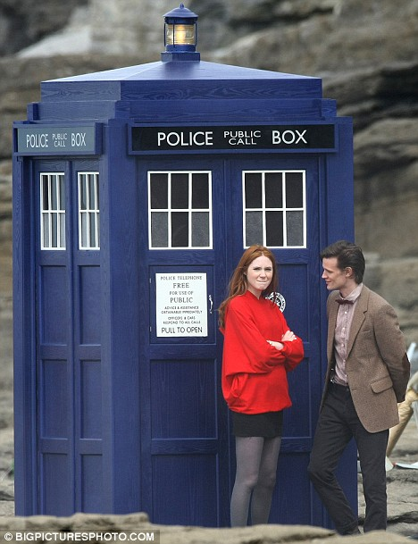 Matt Smith as the Eleventh Doctor and Karen Gillan as Amy Pond outside the new TARDIS