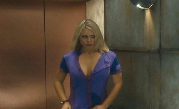 Billie Piper straightens her top